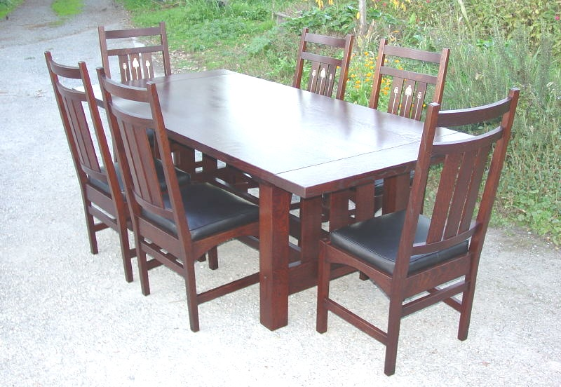Shown without leaves surrounded by six inlaid dining chairs. Voorhees Craftsman Mission Oak Furniture   Gustav Stickley Harvey