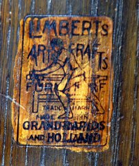 Signed in the drawer with the firms brand: