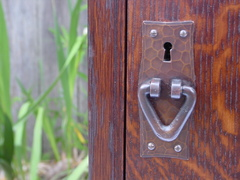 Detail hand hammered copper door pull.