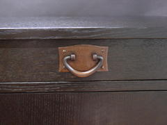 Close-up hand-hammered copper drawer pull.