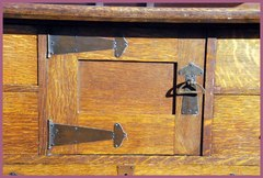 Detail strap hinge hardware on door.