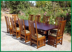 Set of ten chairs around one of our large tables with both end leaves installed.