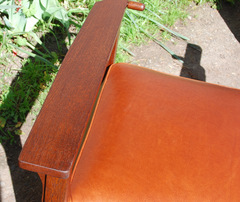 Detail chair arm & quality leather upholstery.