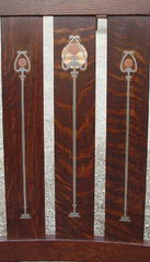 Close-up of the pewter, copper and curly maple inlay showing greater contrast between the inlay and the darker stain on this additional set.