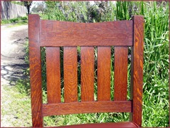 Detail of the excellent quarter-sawn grain and the double pinned mortise and tenon constructed crest rail chair back.