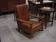 Stickley Brothers lamp table shown with large Gustav Stickley rocker.