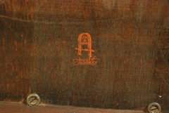 "Signed with the red decal joiners mark above ""Stickley"" in a rectangle circa 1902-1903."
