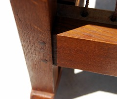 Double pinned mortise and tenon joinery where front seat rail meets the leg.