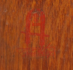 "Gustav Stickley large 1 1/2"" red decal with ""Stickley"" in a rectangle below the joiner's compass encompassing the motto: ""Al ik Kan"",  1902 - 1903."