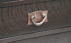 Detail hand hammered copper pull, an accurate replica of an original Gustav Stickley pull.