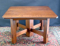 Same model table in a lighter stain.