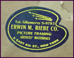 Close-up New York frame shop label.