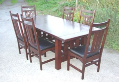 Shown without leaves surrounded by six inlaid dining chairs.