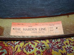 Close-up red rectangular paper label, The Harden Line, Camden, N.Y.