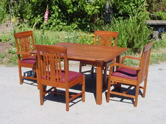 Four chairs shown with custom dining table.