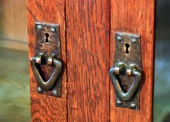 Hand hammered copper pulls.