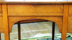 Center drawer with original lock & key above an arched support.