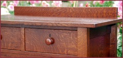 Detail of the authentic turned wooden handle and the excellent hand-selected quarter-sawn oak grain. (The top two drawers on this highboy were ordered with optional locks at an additional cost).