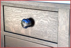 Close-up of smaller upper drawer and turned oak pull.