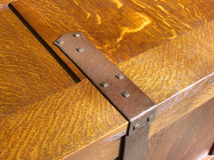 Close-up of hand-hammered hasp hardware.
