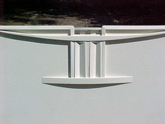 Close-up Mackintosh inspired headboard.