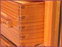 Detail exposed dovetail drawer construction and Ebony pegs.