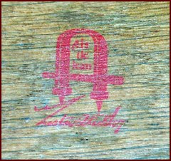 Gustav Stickley's firm's red decal signature used from 1905 to 1912.