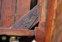 "Stickley Brothers signature ""Quaint"" brass tag underneath chair bottom"