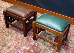 Shown in a darker stain with brown leather and in a light stain with green leather.