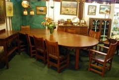 Gustav Stickley 60 in. 5-leg dining table & 10 v-back dining chairs with original leather & pyramid tacks .