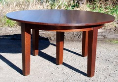 Gustav Stickley original 60 inch diameter oak 5 leg dining table with 5 leaves, opens to 10 feet.