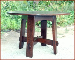 Replica Gustav Stickley splay leg table.