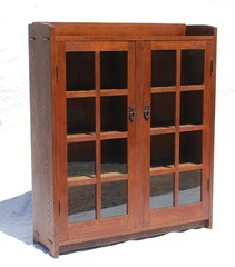 Original Gustav Stickley two door oak bookcase, signed.  1907 - 1912