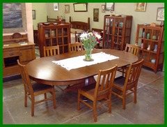 Original Stickley Brothers Dining Table with 4 leaves.