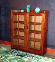 Gustav Stickley 2 door 48 inch bookcase model 717, signed with red decal & paper label.