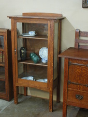 Charles Limbert Diminutive single door china display cabinet