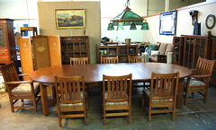 Original Vintage Gustav Stickley 5 leg stretcher base 60 inch dining table with 6 original leaves.  Opens to 11 feet.