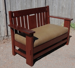 Charles Stickley cut out settle, signed.