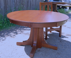 Stickley Brothers 48 in dining table with three leaves.  Signed.  Professionally refinished.
