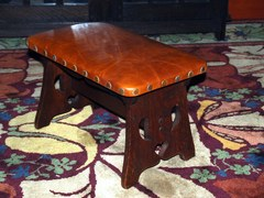 Original Limbert footstool with cut out design in original finish signed by brand