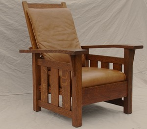 Stickley Era Quaint Art Slant Arm Morris Chair with leather cushions.