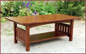 Coffee Table with arched apron, overhanging top & slatted sides.