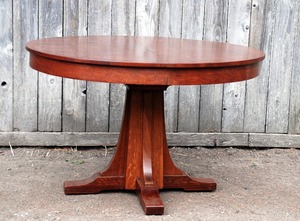 Vintage L.& J.G. Stickley  Antique 48 inch dining table with 4 original leaves in their original leaf rack, signed.