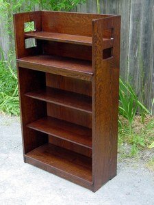 Replica Charles Limbert open bookcase with square cut out design.