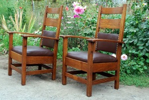 Pair of Stickley Brothers bow-arm chairs.