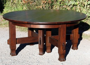 Vintage early 8 leg 60 in stretcher base dining table with 5 leaves opens to 10 ft Stickley era