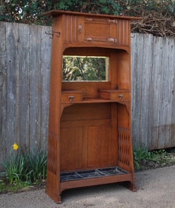 English Arts and Crafts cabinet with hand-hammered copper strap hinges, possibly Liberty.  Umbrella, coat rack, hat rack