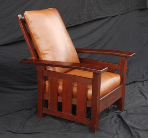 Vintage Stickley Era Arts and Crafts Slant Arm Morris chair with slats to the floor
