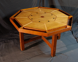 Rare L. & J. G. Stickley octagonal game table with ebony, mahogany, walnut & maple inlays.  Signed.